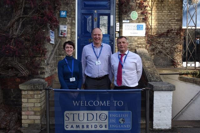 Academic managers at Studio Cambridge posing in front of Main School steps on Station Road