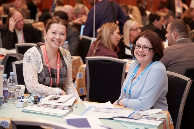 Nicole Kennedy, Sales Director of Studio Cambridge Language School, sits with on of our agents at ICEF conference in Berlin.