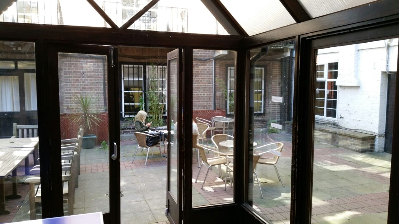 Conservatory opening onto courtyard at Sir William summer camp in London