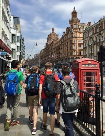 Back of group of students on walking tour around London on excursion at Sir Laurence residential English summer camp