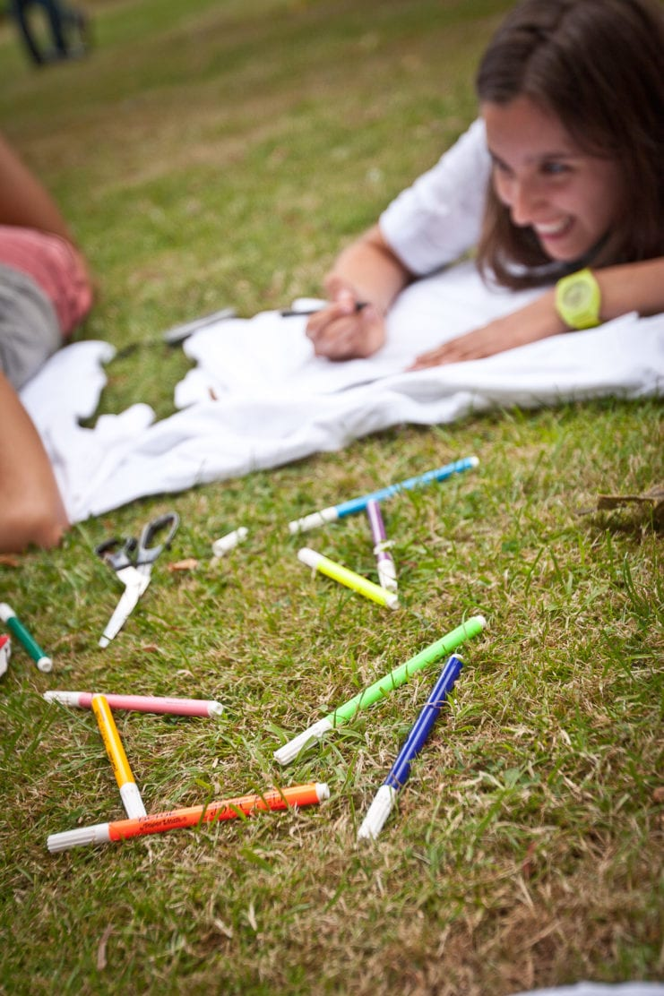 Students lie on lawns and design their own t shirts at Sir Laurence Intensive English Summer camp, based in Lucy Cavendish college, Cambridge