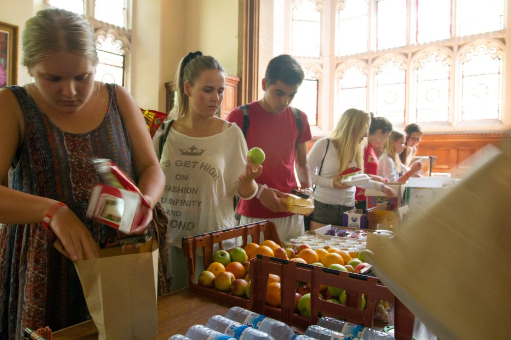 Sir Christopher students select healthy food from dining hall in Ridley Hall College, Cambridge, to help them focus on English language lessons