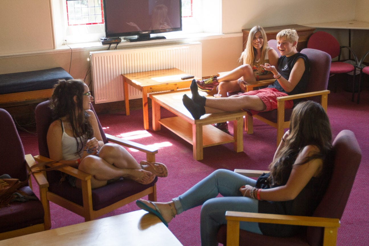 Students make friends in common room at Sir Christopher English summer camp for teenagers