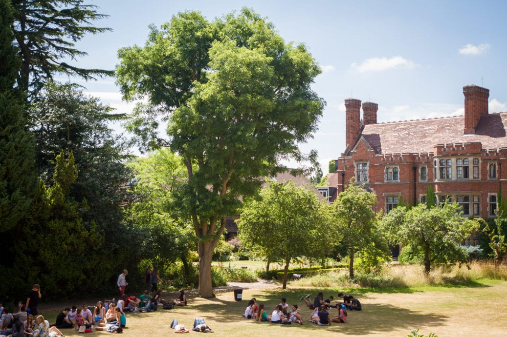 Far shot of Sir Christopher summer camp students on the lawns of Ridley Hall College in the sun