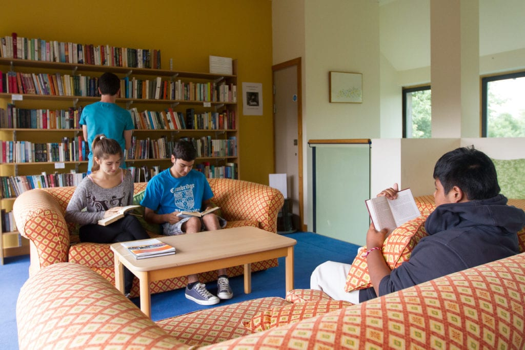 Students read in Lucy Cavendish library at Sir Laurence residential English summer camp