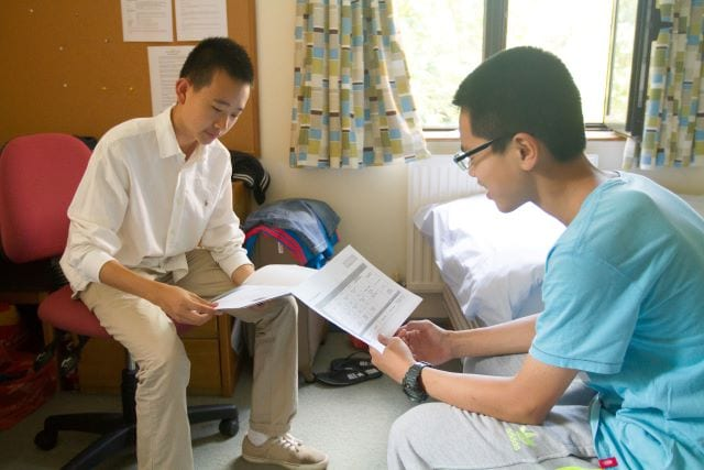Two students study in single bed room at Sir Laurence residential English summer camp
