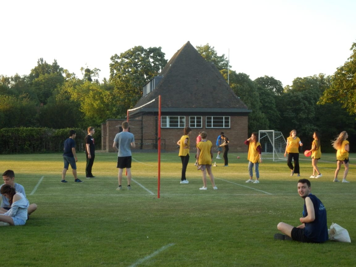 Students play volleyball at a Studio Cambridge English summer camp for teenagers