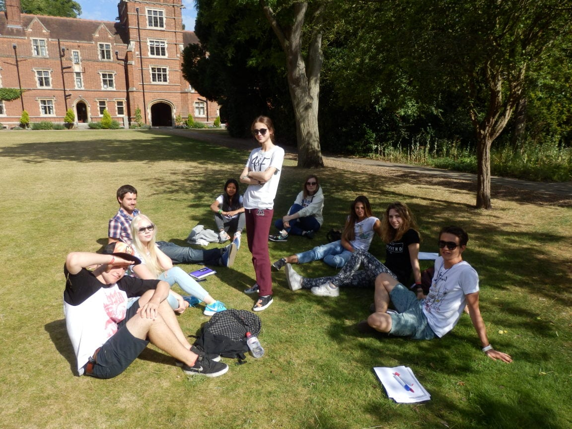 Sir Christopher students relax after English lessons on the lawn at Ridley Hall College.