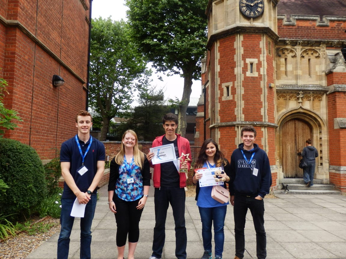 Sir Christopher students pose for a photo with some staff members outside Ridley Hall College, holding their end-of-course certificates.