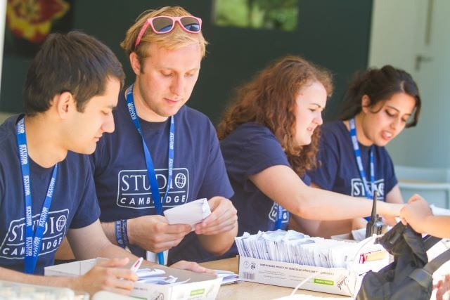 Welfare team busy with check in for students at Sir Henry residential English summer camp