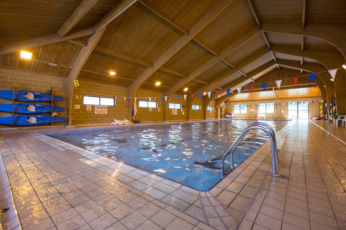 On-campus swimming pool at Sir Richard residential English summer camp, based in Leighton Park School