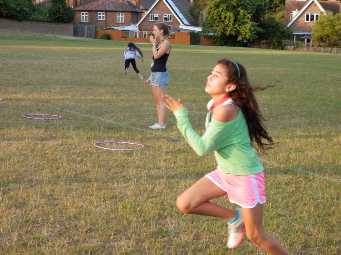 Students doing athletics on field at Sir Edward residential English summer camp