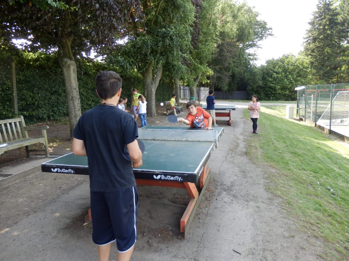 Students play table tennis outside at Sir Henry residential English summer camp