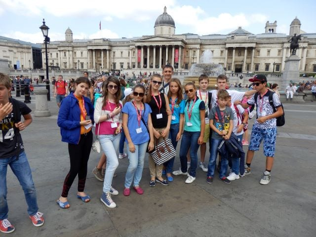 Group of students pose for picture in front of Trafalgar Square, London, on an excursion at Sir Richard residential English summer camp
