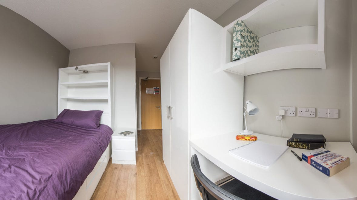 A single en-suite bedroom at Tripos Court. Bedrooms have a private bathroom, single bed, desk e and wardrobe.