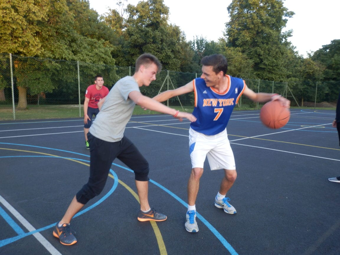 Students play basketball at a Studio Cambridge summer camp.