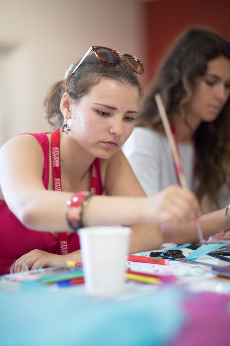 Students painting at English residential summer camp