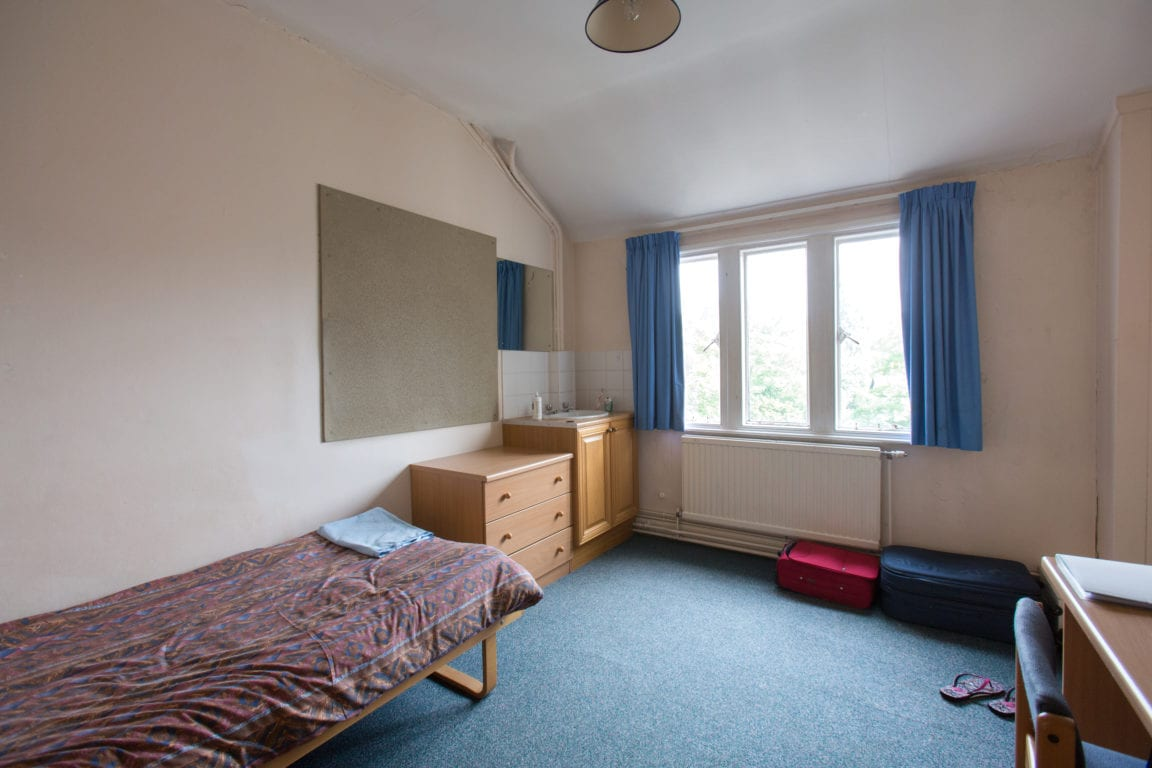 Single room with noticeboard, desk and sink in Richmond the American International University in London, base for Studio Cambridge English summer camp Sir William
