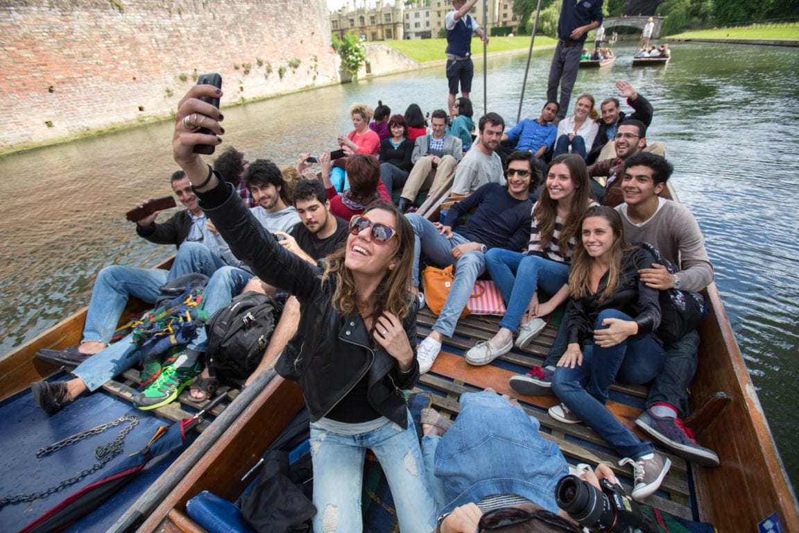 Students take a selfie on a punt in Cambridge on the River Cam.