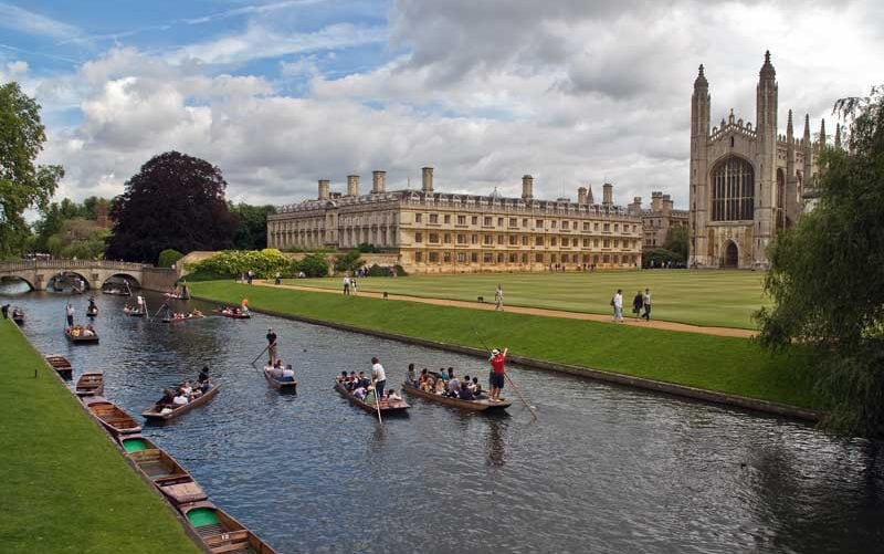 Tourists punting on the River Cam in front of Clare College and King's Chapel, Cambridge.