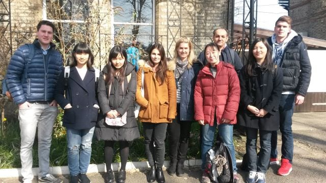 Adult students in group outside Studio Cambridge English language school