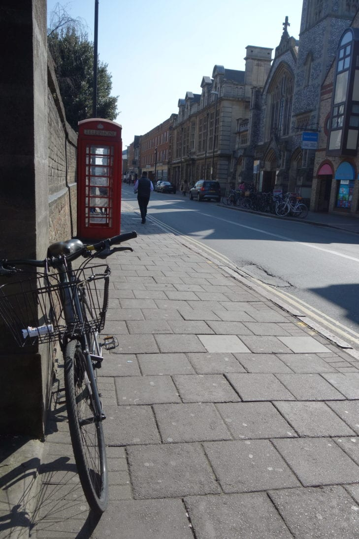 English bike and phone box on street in Cambridge, UK.