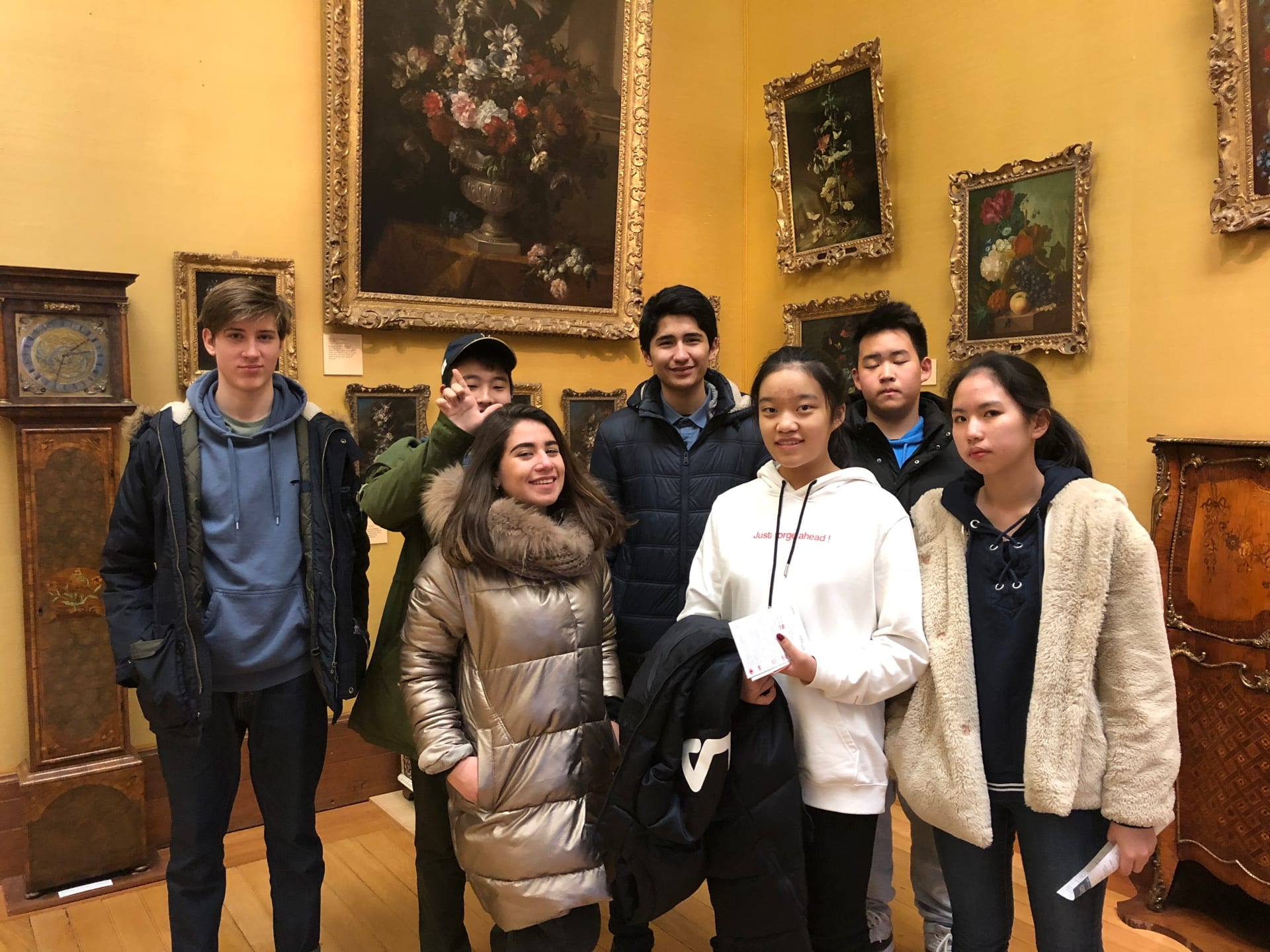 A group of Sir George students year-round English camp stand in the Fitzwilliam Museum, Cambridge, on one of their cultural activities