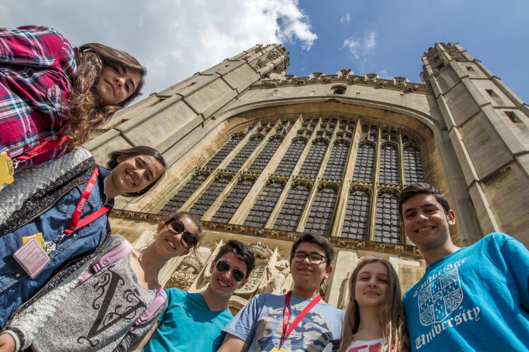 Low angle shot of 7 Sir Laurence English summer camp students standing in front of King's College Chapel, Cambridge.