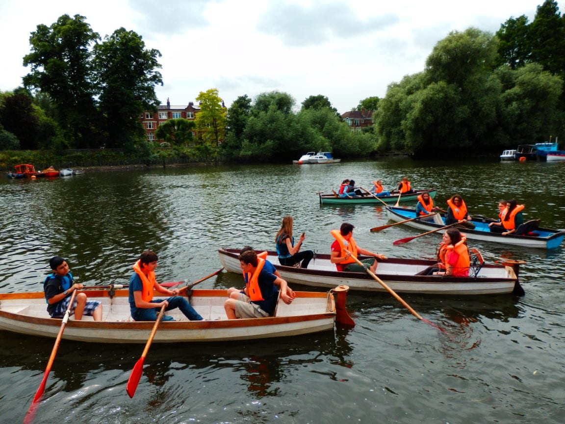 Sir William English summer camp students wearing lifejackets rowing boats on the River Thames.