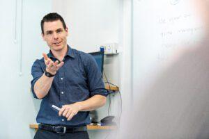 CELTA teacher at whiteboard