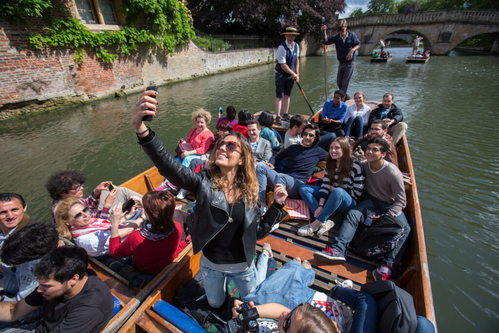 A group of students punting on the River Cam