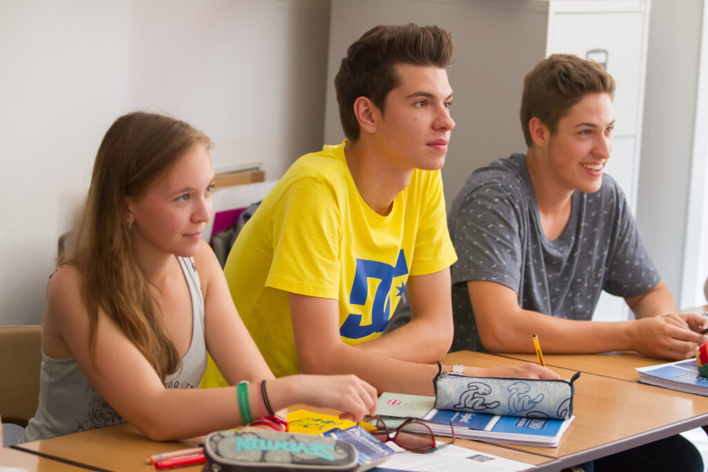 Teenagers enjoying English camps for young learners
